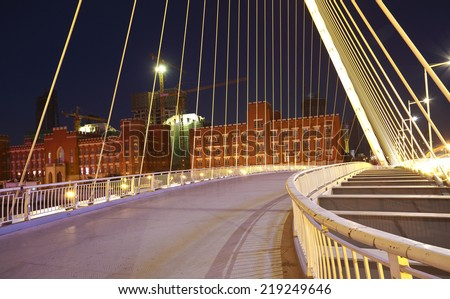 Arc type concept harp cable bridge of highway car light trails city night landscape - stock photo