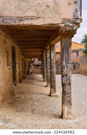 Arcades and old houses, typical medieval architecture in Calatanazor, Soria, Spain - stock photo
