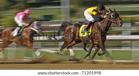 ARCADIA, CA - FEB 5: Jockeys storm down the homestretch in a claiming race at Santa Anita Park on Feb 5, 2011 in Arcadia, CA. - stock photo