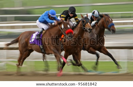 ARCADIA, CA - FEB 19: Jockeys struggle for the lead in the 6th race at Santa Anita Park in Arcadia, CA, on Feb 19, 2012.