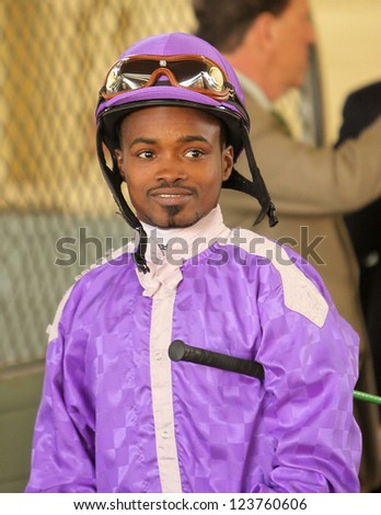 ARCADIA, CA - JAN 5: Jockey Kevin Krigger is all smiles after winning the Grade 1 Sham Stakes at Santa Anita Park on Jan 5, 2013 in Arcadia, CA. Here in the paddock, he waits for his next mount. - stock photo