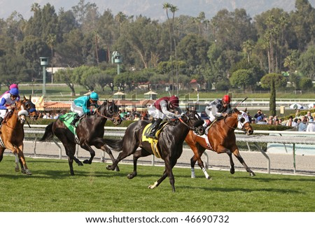 ARCADIA, CA - 30 JAN: Kuro (#4), with Michael Baze in the irons, moves up on Deputy Max en route to breaking his maiden at Santa Anita Park on Jan. 30, 2010 in Arcadia, CA.