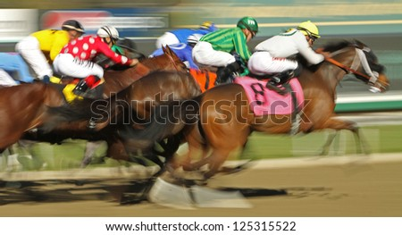 "ARCADIA, CA - JAN 17: The field flies down the homestretch in a claiming race at Santa Anita Park on Jan 17, 2013 in Arcadia, CA. Winner is Kevin Krigger (black cap on rail) and ""Sweetrayofsunshine"". - stock photo"