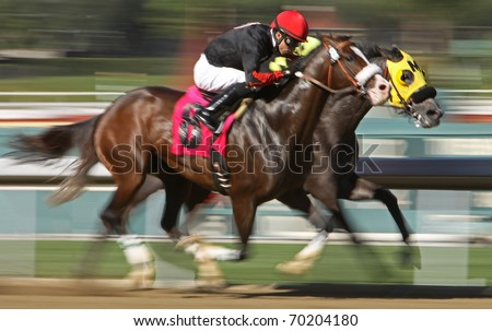 ARCADIA, CA - JAN 29: Two jockeys battle for the lead in a maiden claiming race at Santa Anita Park on Jan 29, 2011 in Arcadia, CA.