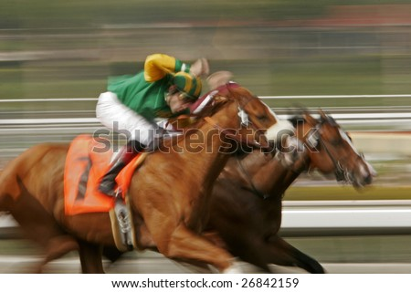 ARCADIA, CA - MAR 14, 2009: Jockey Iggy Puglisi and Carson's Copper compete in a claiming race at Santa Anita Park, Arcadia, CA, on March 14, 2009