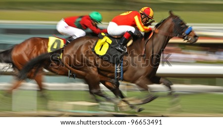 "ARCADIA, CA - MARCH 3: Jockey Martin Garcia pilots ""Mile High Magic"" to his first win at Santa Anita Race Track on March 3, 2012 in Arcadia, CA. - stock photo"