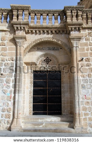 Arch and door of old house in Midyat, Turkey