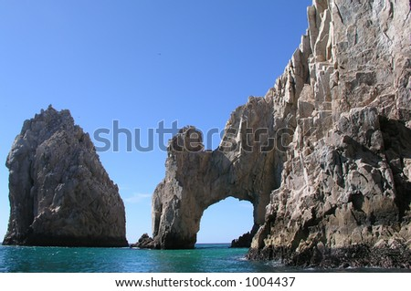 Arch and rock in Cabo San Lucas - stock photo
