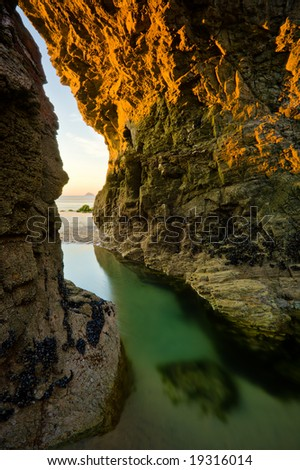 Arch at the beach at the Cornish Coast, England - stock photo