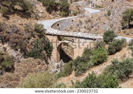 Arch bridge in the small village Rodakino on Crete. The route leads along south west coast of Crete from Plakias to Hora Sfakion to the White Mountains  or Lefka Ori - stock photo