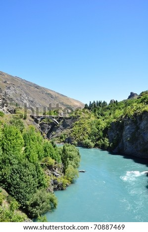 Arch bridge over Kawarau river in Queenstown, New Zealand - stock photo