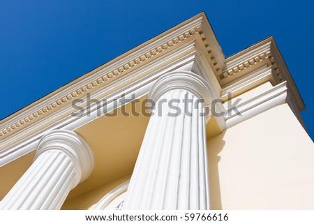 Arch columns under blue sky - stock photo