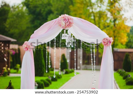 Arch for the wedding ceremony. Wedding floristic composition - stock photo