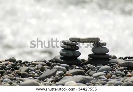 Arch from sea stones - stock photo