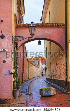 Arch in Pilies Street in the Old Town of Vilnius in Lithuania in winter - stock photo