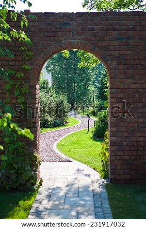 Arch in the garden - stock photo