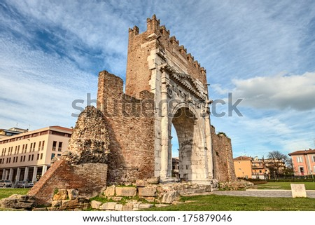 Arch of Augustus  in Rimini, Italy - ancient romanesque gate of the city - historical italian landmark, the most ancient roman arch that still stands intact  - stock photo