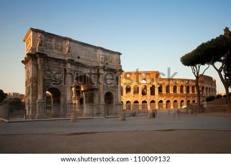 Arch of Constantine and Colosseum at sunset, Rome, Italy - stock photo