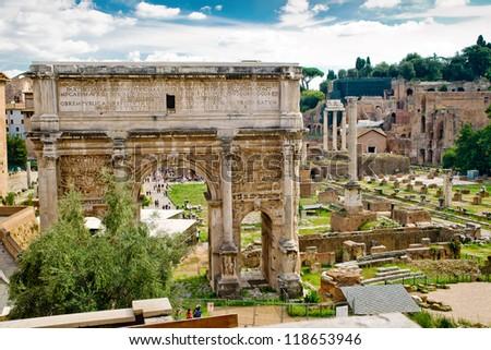 Arch of Emperor Septimius Severus and the Roman Forum in Rome, Italy - stock photo