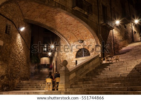 Arch of the Agullana Palace and Sant Domenec stairs at night in Girona, Catalonia, Spain