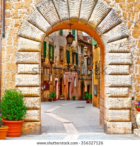 Arch of the Narrow Street with Old Buildings in the Medieval Italian City  - stock photo