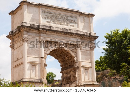 Arch of Titus is a 1st-century honorific arch located on the Via Sacra, Rome, just to the south-east of the Roman Forum. - stock photo