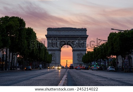 Arch of Triumph (Arc de Triomphe) with dramatic sunset behind, Paris, France