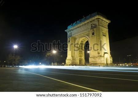 Arch of Triumph in Bucharest - Romania night scene - stock photo