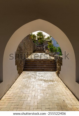 Arch overlooking the landscape - stock photo