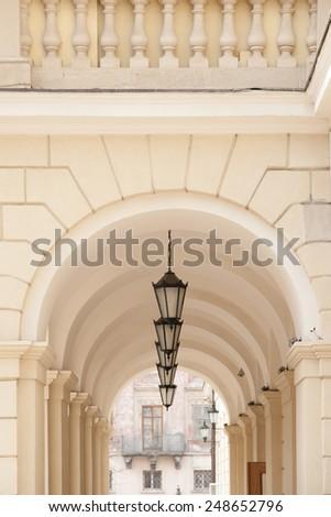Arch passage of Lviv city hall on Market square - stock photo