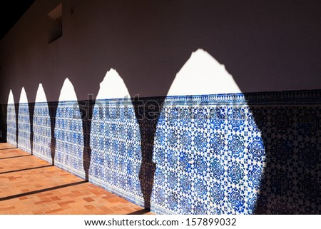 Arch Shadow at Azulejo Wall. Cloister detail in Convent of Christ, Tomar, Portugal - stock photo
