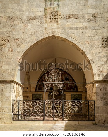Arch with decorative lattice, entrance of the Cathedral of Saint James in the Armenian Quarter of Jerusalem, Israel