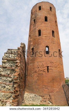Archaeological Park with Palatine towers (Porte Palatine), ancient Roman city gates of Turin, Italy - stock photo