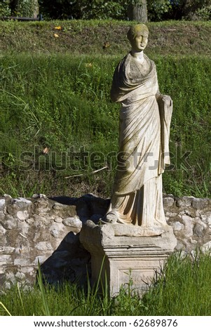 Archaeological site of ancient Dion of Katerini city in north Greece Temple of Isis with the Statue of the Goddess - stock photo