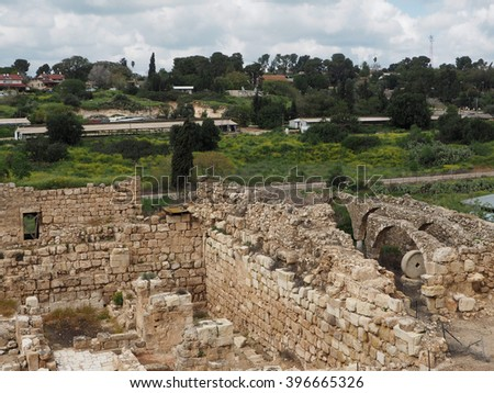 Archaeological site with kibbutz in the background   - stock photo