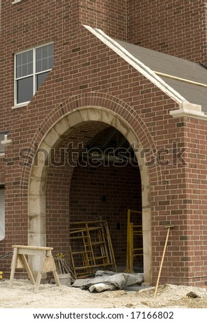 Arched brick entrance to home