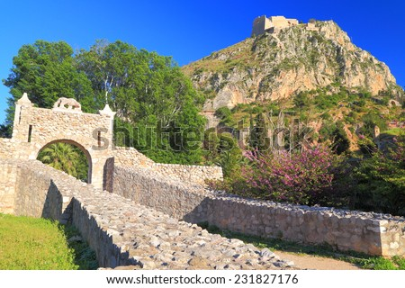 Arched gate to Palamidi fortress built on tall hill above Nafplio, Greece - stock photo