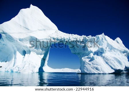 arched iceberg Pleneau bay Antarctica - stock photo