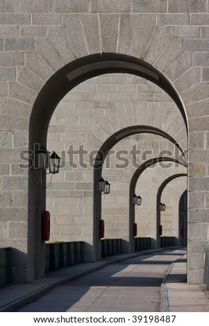 Arched Path over the weir of Jochenstein Hydro-power Station - stock photo