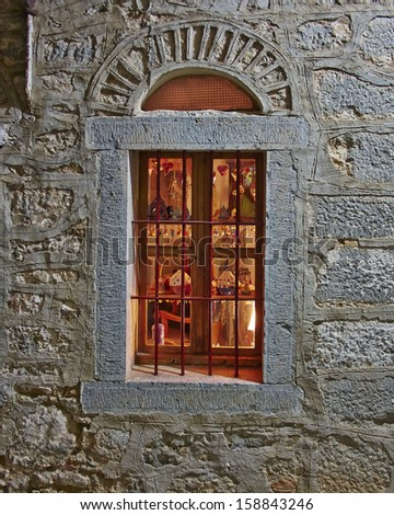 arched window lit, Chios island, Greece - stock photo