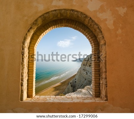 arched window on the coastal landscape of a bay - stock photo