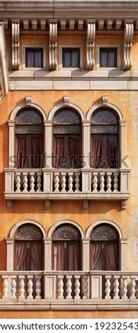 Arched windows of a house texture. Venetian gothic architectural style. - stock photo