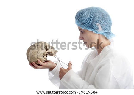 archeology or criminology: mature woman with skull. isolated on white background - stock photo