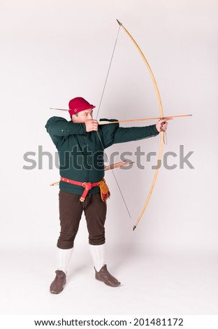 Archer in a historical costume with bow