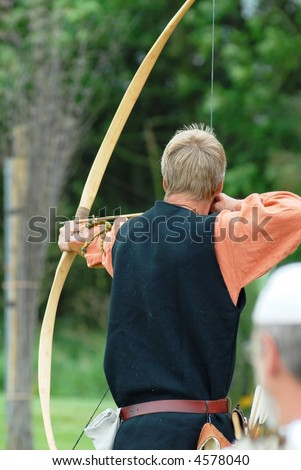 Archer shooting arrows at targets - stock photo
