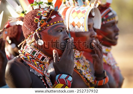 ARCHERS POST - KENYA - JANUARY 14, 2015: Unidentified Samburu warriors singing at a wedding ceremony on January 14, 2015 in Archers Post, Kenya.  - stock photo