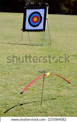 Archery bow and a target  ready to be use.