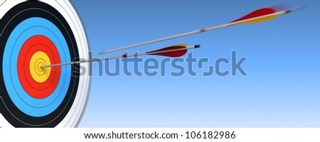 archery, target and arrow over blue sky background with one arrow in action and the other one who have reach the center - stock photo