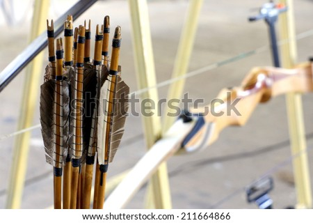 Archery with bow and arrows - stock photo