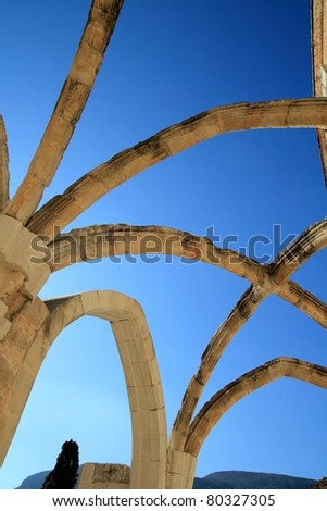 Arches from stone structure of ancient Monastery in Spain - stock photo
